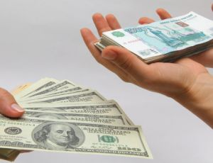 Доллар теряет позиции из-за подорожания нефти